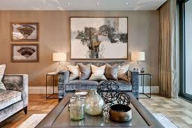 sitting room featuring grey themed sofa and table in belgravia apartment
