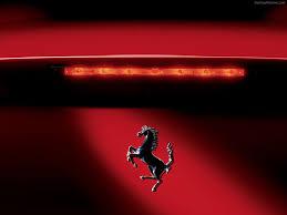 black ferrari logo wallpaper. black ferrari logo horse with red background wallpaper