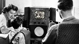 family watching tv 1950s. composite image showing a family watching tv in the 1950s [image: getty], tv