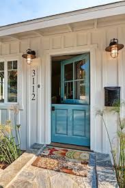 barn style front doorDecorating with Doors Inside and Out  Town  Country Living