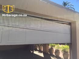 broken steel garage door