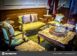 classical living room british style with armchair and chess photo by my