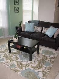 excellent decoration rug over carpet living room room rug over carpet living room home design wonderfull