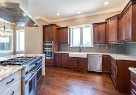 castle rock builder spec home with island subway tile and farm sink