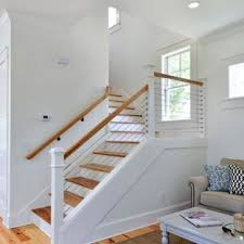 Farmhouse stair railing Silent Inspiration For Midsized Country Wooden Lshaped Cable Railing Staircase Remodel In Houzz Railing Farmhouse Staircase Photos Houzz