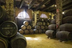stacked oak barrels. Stacked Oak Barrels In One Of The Cellars At Bodega 7