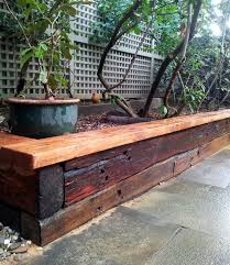 Small Picture Stained railway sleeper garden bed Home design Pinterest