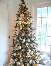 ... Christmas tree with golden accents flanking the fireplace View ...