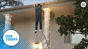 Clark Griswold Hanging Lights Man Tries To Save Fake Clark Griswold Part Of Christmas Display