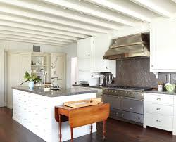 corner range hood Kitchen Traditional with cup drawer pulls drawer. Image  by: Peter Zimmerman Architects