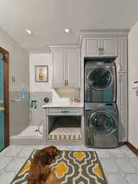 Mid-sized elegant single-wall porcelain floor and gray floor utility room  photo in