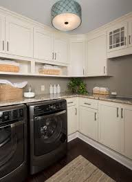 Use a flush mount light with a drum shade to brighten a laundry room. Photo