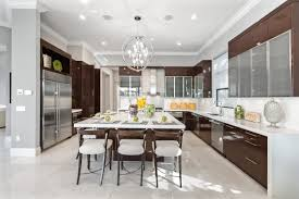 large u shaped modern kitchen with square island that accommodates 5 stools notices the