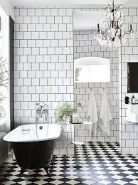 modern black and white bathrooms. this ornate antique chandelier adds plenty of glam to modern black and white space featured on my scandinavian home. hanging out in style: 15 bathrooms a