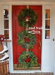 front door wreath hangerChristmas Door Ideas Decorate with Triple Wreaths