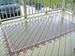 painting a pattern on your deck to look like a rug is a great idea