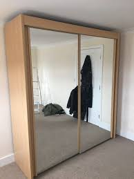 large double wardrobe with sliding mirrored doors made by buche hell nb