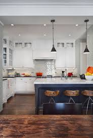 if you are looking for a more neutral colour then consider grey or black for your kitchen island these beautiful examples show that grey and black works
