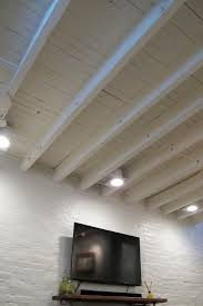 exposed ceiling lighting. Exposed Ceiling In A Shallow Basement - Paint The Rafters Instead Of Covering Them Up To Lighting H