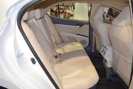 2018 toyota camry hybrid rear seats right side view at 2017 dubai motor show