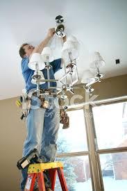 installing chandelier electrician installing chandelier install chandelier on sloped ceiling