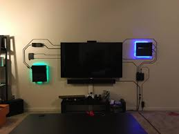 this home theater setup makes exposed wires look cool rh cultofmac com custom home theater rooms installing home theater speakers wiring