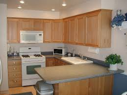 White Appliances In Kitchen Brown Kitchen Cabinets With White Appliances Quicuacom