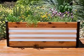 garden materials. This Raised Garden Bed Is Made From Two Materials. The Metal Provides And Interesting Materials