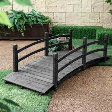 6 ft outdoor wooden garden bridge with handrails in dark charcoal garden with a bridge rock