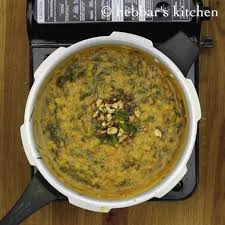 once the garlic turns golden brown mix the seasoning ings to palak dal give a good stir to palak dal palakura pappu your palak dal