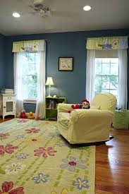 baby nursery floor idea with fl area rug on wood floor