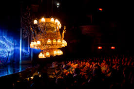 the famed chandelier in the al the phantom of the opera moves over the