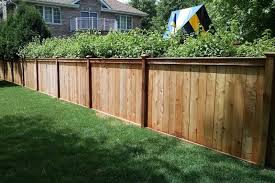 il photo of a custom wood fence installed by first fence company in hillside