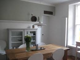 Dining area in Farrow & Ball Mizzle and white Cabinet in F&B