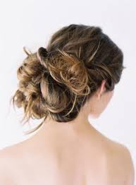 twisted piecey updo if your beach wedding