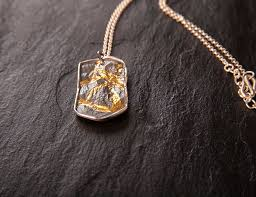 military tag pendant in silver and gold
