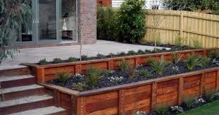 slope with wood retaining wall ideas