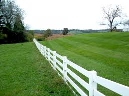 white fence. White Fence And Green Grass