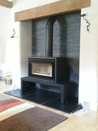 stovax freestanding studio with slate hearth and slate split tile back wharfe valley stoves installations slate hearth hearths and slate