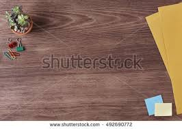 Office Supplies on a Wooden Table Desk. Top View