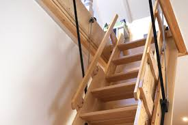 tactile easy to open and aesthetically beautiful our wooden automatic loft ladders will enhance any new room without compromising on the space available