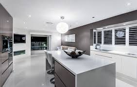 modern kitchen with dark gray cabinets and white solid surface countertops