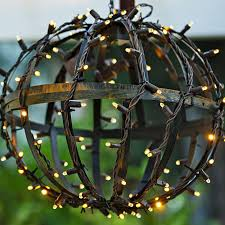 outdoor lighting balls. make festive globe lights to hang from a pergola by joining two hanging baskets into ball shape then wrap with string 2 joined outdoor lighting balls