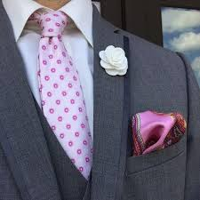 white lapel flower on gray suit