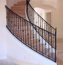 Interior wrought iron stair rails with newel posts, baluster collars,  twisted pi mediterranean-