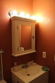 over bathroom cabinet lighting. wonderful lighting furniture attractive bathroom lighting for medicine cabinets using bulb  wall sconce over mirrored swing doors with in over bathroom cabinet lighting v