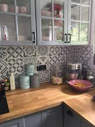 wood countertops love the warm wood tones with the two tone gray and patchwork tile backsplash
