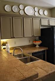 Above Cabinet Decor How To Decorate Above Kitchen Cabis Kitchen Amazing Above Kitchen