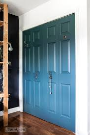 homestead blue fusion mineral paint closet doors with hooks in the boy s bedroom funkyjunkinteriors