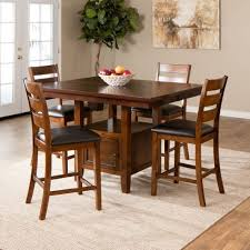 the taylor counter height set offers fine craftsmanship style featured in a warm brown finish on solid hardwood and veneers the table